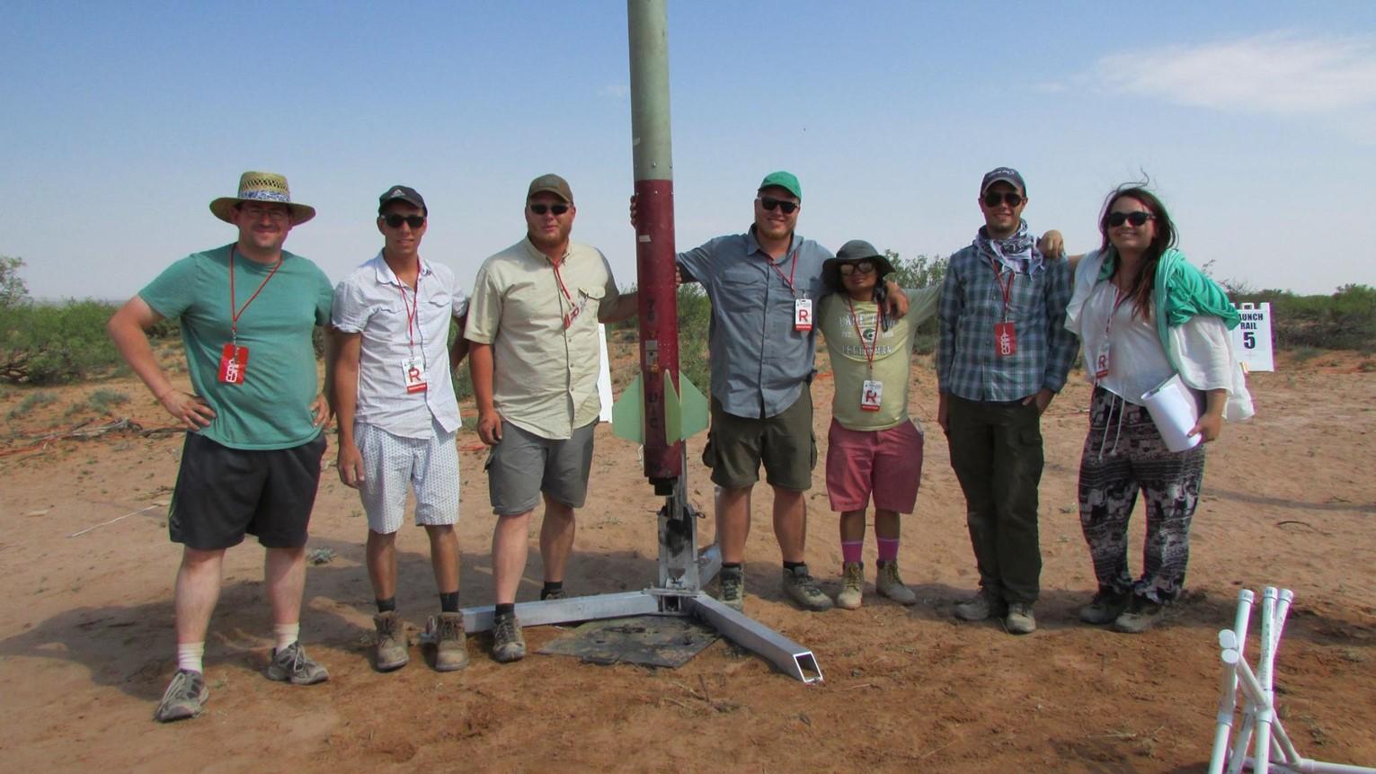 team posing in the field