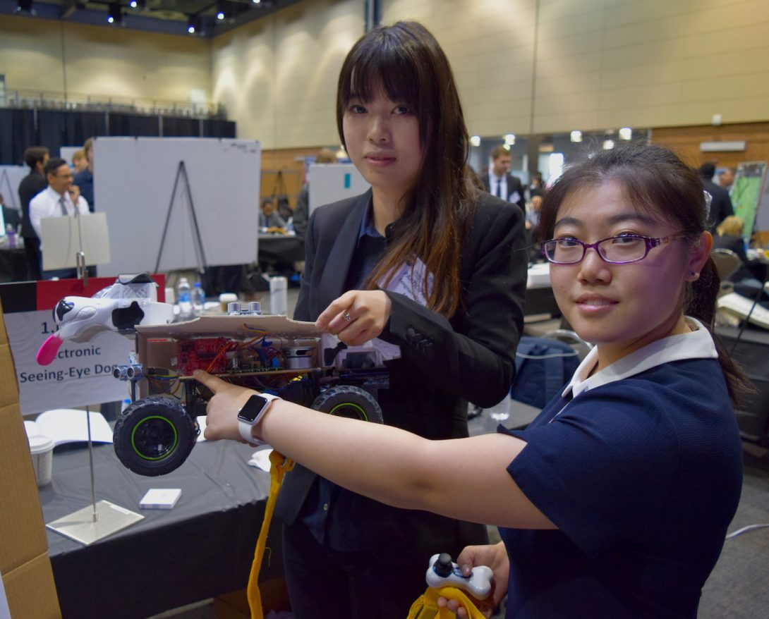 Chinese students displaying their prototype