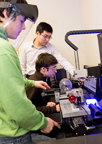 students at work in Jie Xu's lab