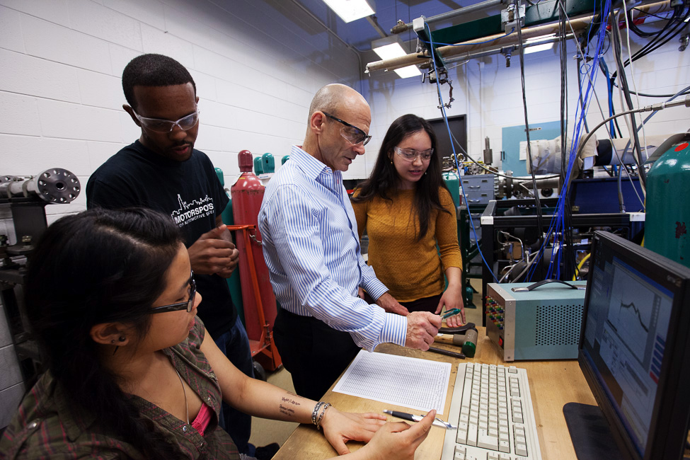 students and faculty in a research lab