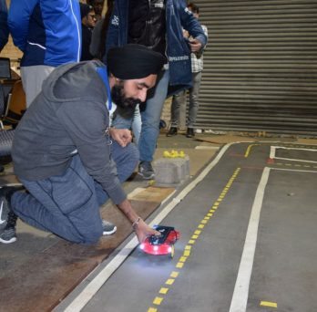 UIC student places an AV on the track during the new course in the College of Engineering.