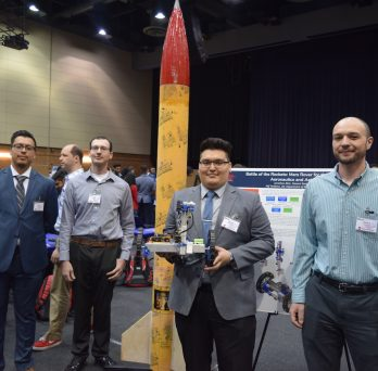 MIE team with rocket at Expo 2019