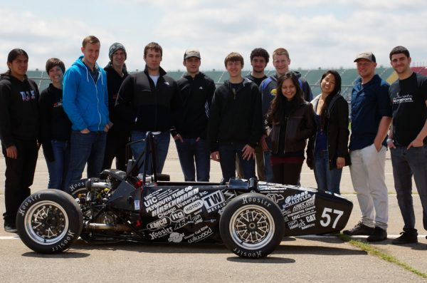 SAE students with formula car