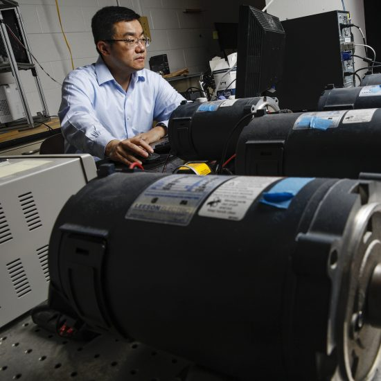 IE faculty member Lin Li in his lab